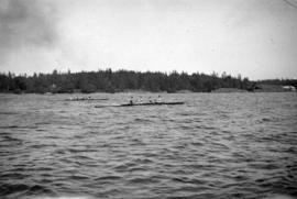 [Two four-man sculls racing in local waters]