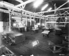 [Interior of salmon cannery, showing equipment and machinery]