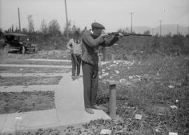 [Man with a rifle at a shooting range]