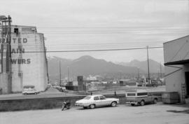 Parking lot and grain tower on south side of Burrard Inlet