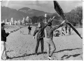 Ted Rawson flying kite on Kitsilano Beach