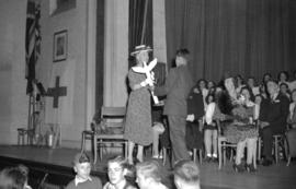 [Indian boy presenting Princess Alice with a totem pole at Kerrisdale School]