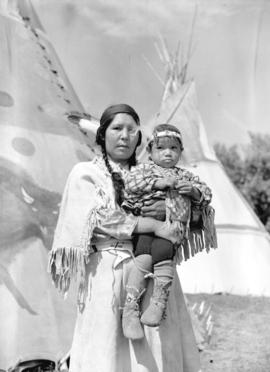 [Stoney Woman and child at the Calgary Stampede]