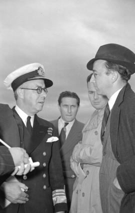 [Vice Admiral Percy W. Nelles talking with reporters at the Vancouver Airport]