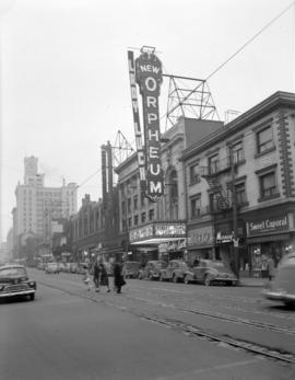 [View looking north on Granville Street showing the Orpheum Theatre, with advertising for the mov...