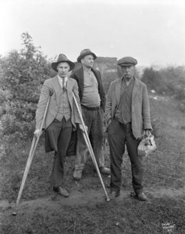 [Three unemployed men of the 'jungle' at the City dump]