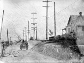 [Horse and cart travelling along 34th Avenue (now 33rd Avenue) before paving]