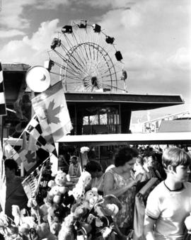 Concession stand and Ferris wheel in P.N.E. Playland
