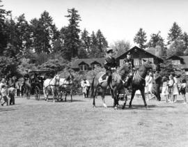 [Former Alderman Frank Baker escorted by mounted police travel past the Pavilion during the 75th ...