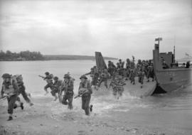 Troops landing [from barges at Kitrsilano Beach]