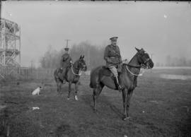 [Two soldiers on horses]
