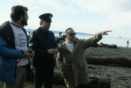 Commissioner, police officer and man on beach at Polar Bear Swim