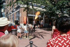 Vancouver Day attendees watching performer breathing fire
