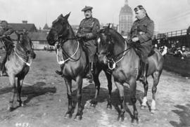 [Two officers on horses at the Cambie Street Grounds]