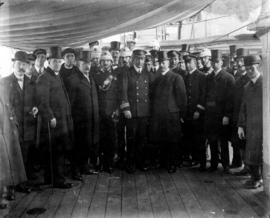 "[Group portrait of various dignitaries aboard the H.M.C.S. ""Rainbow""]"