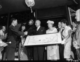 Canadian Prime Minister J.G. Diefenbaker and wife, Olive Diefenbaker, receiving gift at Taiwan ex...