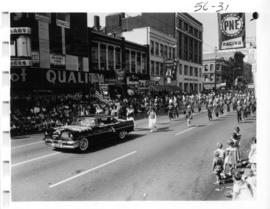 Vancouver Elks decorated car and Nooksack Valley Pioneers band in 1956 P.N.E. Opening Day Parade