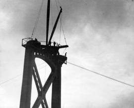 5:23 a.m. Three of the eight-ton cables for catwalks have been raised 325 feet above tide mark.  ...