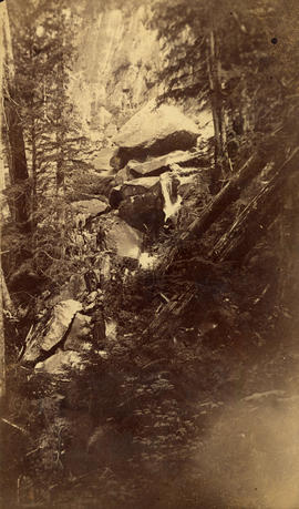 [View of a group hiking among boulders near Howe Sound]