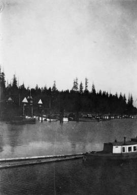 [View of Vancouver Rowing Club and boats in Coal Harbour]