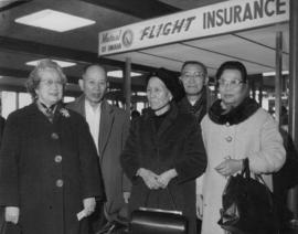 Lillian and Sam with group at airport