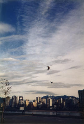 Helicopter delivering the Make Vancouver Sparkle Ford Taurus prize to Vanier Park
