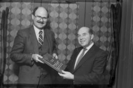Mike Harcourt and Peter Paul Saunders holding award