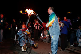 Unidentified torchbearers passing the flame [2 of 2]