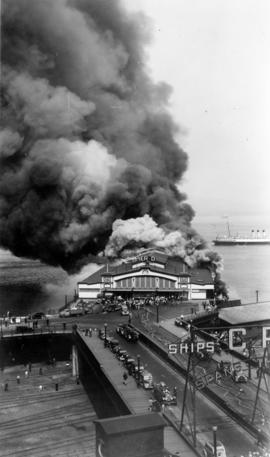 "[Pier D fire with C.P.R. vessel ""Princess Charlotte"" in steam]"