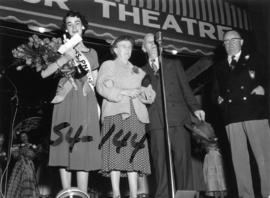 Nancy Hansen on Outdoor Theatre stage with dignitaries after being named Miss P.N.E. 1954