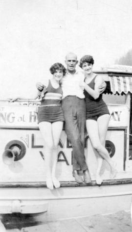 "[Harry Hooper and two unidentified women on his boat ""Lady Van""]"