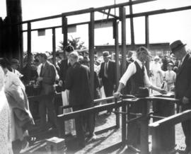 Fairgoers entering turnstiles to Vancouver Exhibition grounds