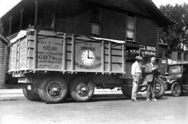 [Driver making delivery with Moreland six wheel six cylinder transport truck]