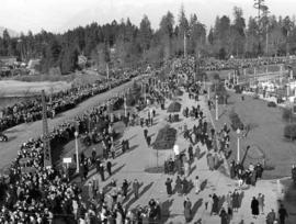 [Crowds line the causeway awaiting the naval and military parade for the memorial service for Kin...