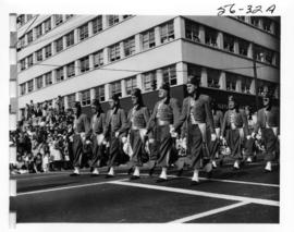 Gizeh Temple Shriners marching in 1956 P.N.E. Opening Day Parade