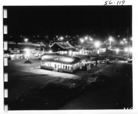 View of illuminated outdoor tents and booths on P.N.E. grounds at night