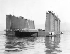 [A drydock being moved into position at North Van Ship Repairs (Pacific Drydock) Limited ]