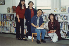 Paul Yee signing book at Richmond Public Library during Asian Heritage Month festival