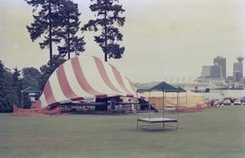 Stage under red and white striped canopy at Stanley Park