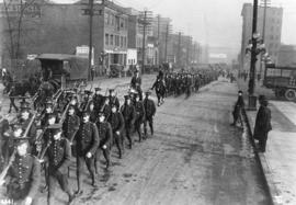[Soldiers marching along Pender Street]