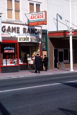 "[View of a] sign, storefront ""Game Ranch,"" Theatre Row, [Movieland Arcade at 904 Granvi..."