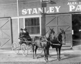 [Alex Mitchell in his buckboard in front of Stanley Park Livery and Stables - S.W. corner of Seym...