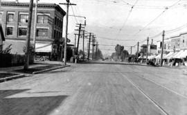 [View of finished] Paving Main St. and 17th Ave. looking north [showing the Winram block]