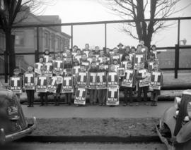 "[Group of boys holding ""T-Men"" posters on the street as part of the movie's promot..."