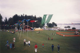 View of Canada Day Festival stage and flags at Brockton Point