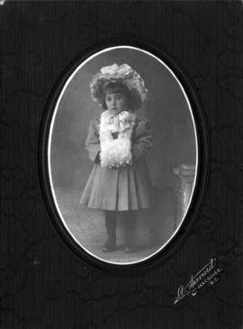 Portrait of a small girl in hat and muff, from French-Canadian community