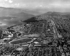 Aerial photograph of P.N.E. grounds and surrounding area looking east, including Second Narrows B...