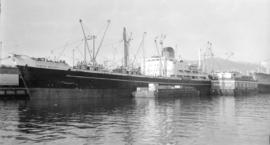 M.S. Kings Reach [at dock, with barges alongside]