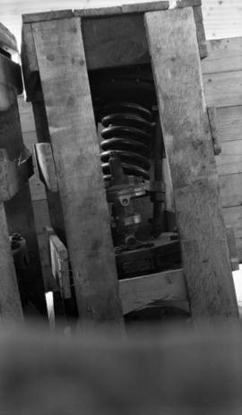 [Unidentified machinery inside a wooden crate, showing coil component]
