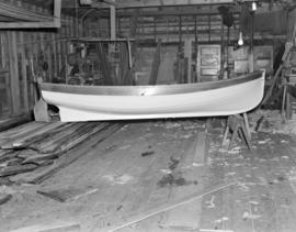 [Small boat under construction]